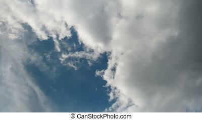 Clouds move across the blue sky. - White, rain, gray, haze,...