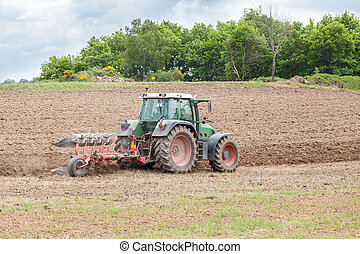 Ploughing an agricultural field for planting - Farmer...
