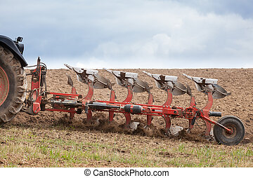 Closeup detail of an agricultural  plough in action