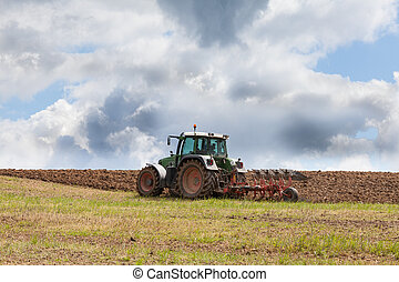 Farmer ploughing an overwintered field ready for planting