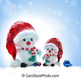 snowmans in red hat on a snowy background - cheerful...
