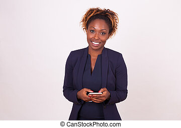 african American business woman using a smartphone - Black...