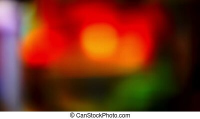 blurred red green glare light background flickering...