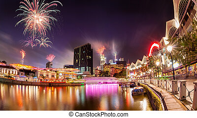 Fireworks Over Singapore River - Fireworks set off in the...