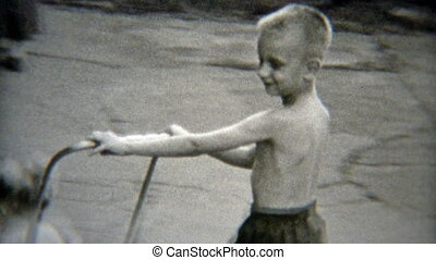 1949: Excited child pushed around - Vintage 8mm film home...