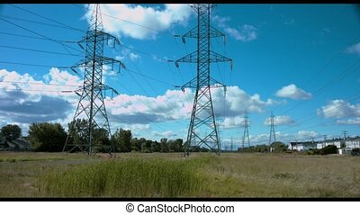 High Voltage pylon - 4k clip of typical north american high...
