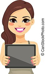 Woman Displaying Tablet - Beautiful brunette woman...