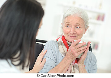 Doctor chatting to an old lady