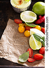 Mexican cuisine ingredients to make avocado sauce and tomato...