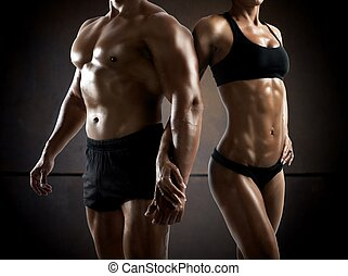 Fitness couple - Couple man and woman muscled and...