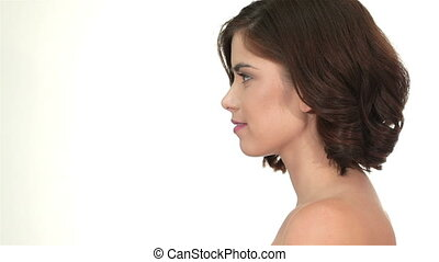 Pretty woman against a white background with copyspace -...