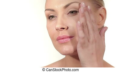 Part of female face and hands, white background, copyspace -...