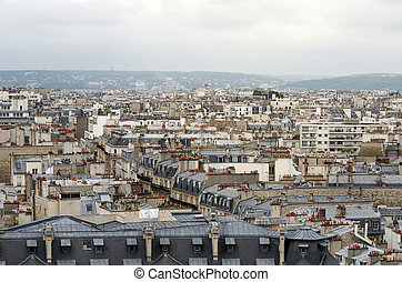 Roofs of Paris with moody sky, France