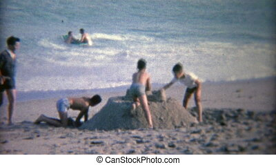 1952: Kids building a big sand