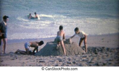 1952: Kids building a big sand - Vintage 8mm film home movie...