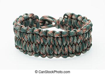 green braided bracelet on white background - white green...