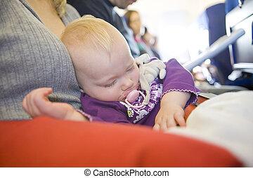 toddler girl sleeping on plane