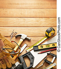 carpentry tools - variety of carpentry tools on wood planks...