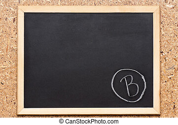 Chalkboard with writing - B written on chalkboard, getting...