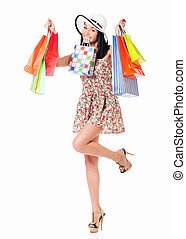 Woman shopping - Young happy woman holding a shopping bags,...