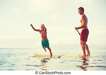 Father and Son Stand Up Paddling - Father and son stand up...