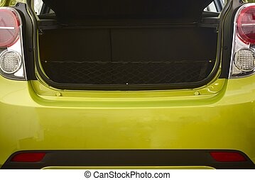 Compact Car Trunk Closeup Photo. Green Body Compact Vehicle.