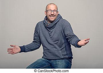 Charismatic man shrugging his shoulders - Charismatic...