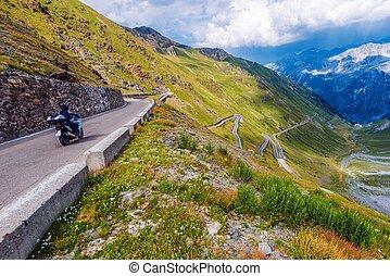 Mountain Road Biking Motorcycle on Italian Stelvio Pass...