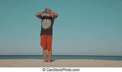 Yoga outdoors on a deserted beach - Yoga outdoors on a...