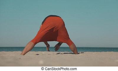 Yoga power exercise on the wild beach - Yoga power exercises...
