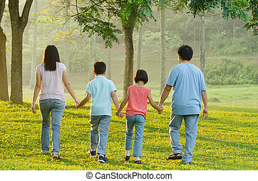 Happy Asian family walking