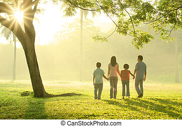 asian family walking outdoor in the morning