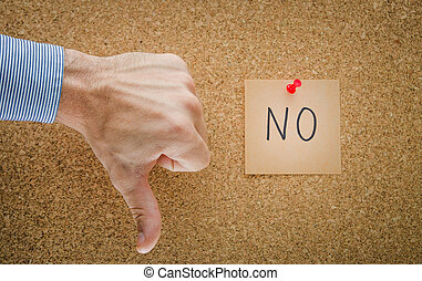 No - Thumbs down with a pinned red paper note with NO...