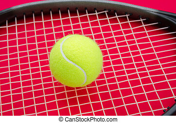 Tennis ball on a raquet with a red alerted serious...