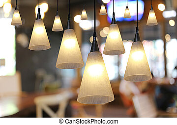 Warm lighting modern ceiling lamps in the cafe - Warm...