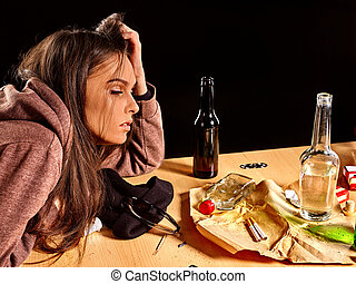 Girl with closed eyes in depression drinking alcohol. - Girl...
