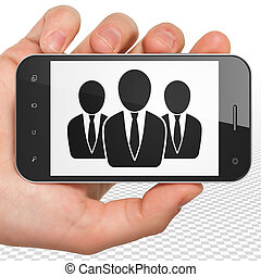 Business concept: Hand Holding Smartphone with Business People on display