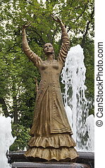 statue of a woman at the fountain