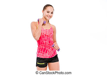 Young sportswoman exercising with dumbbells - Young smiling...