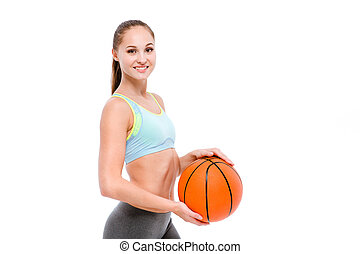 Smiling sports woman holding basketball ball - Portrait of a...
