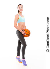 Sports woman standing with basketball ball - Full length...