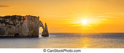 Etretat Aval cliff at sunset - Panoramic view of Etretat...
