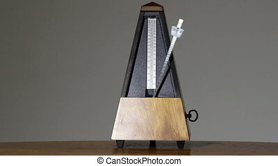 Metronome On Table Gray Background Largo Tempo