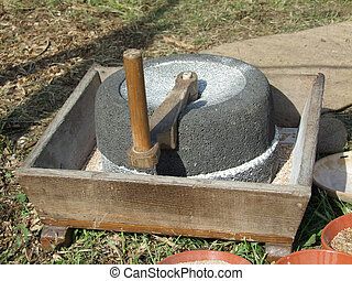 Hand mill - An old marble hand mill at work Shot outdoor