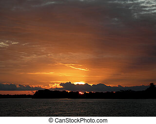 Sunset over the Amazon River - The incredible sunset over...