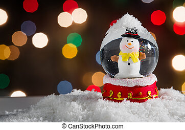 Snow Globe - Snow globe with snowman over christmas lights...
