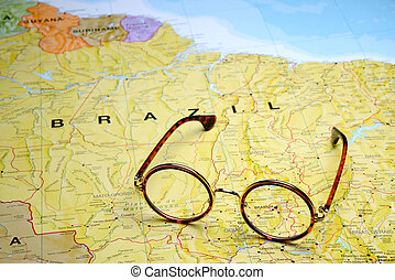 Glasses on a map - Brasilia - Photo of glasses on a map of...
