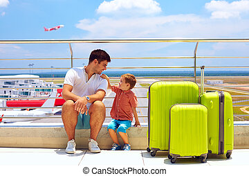 family waiting for boarding in international airport, summer...