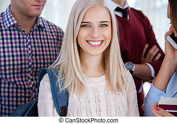 Happy female student looking at camera - Closeup portrait of...