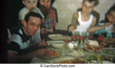 1951: Big family at crowded dinner - Vintage 8mm film home...